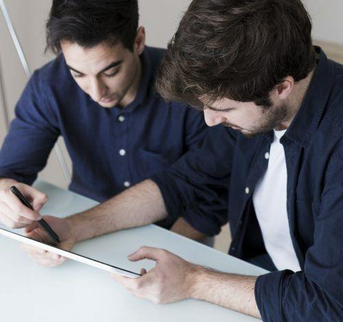 men-discussing-data-tablet